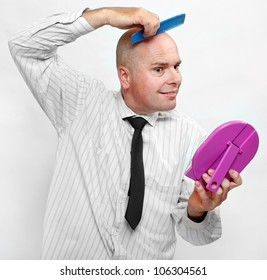 Hairless businessman with mirror - forever beautiful.