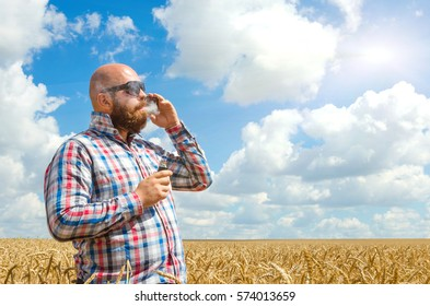 Hairless man with beard in glasses smoke electronic cigarette. outdoor banner blue sky w clouds background
