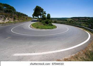 A hairpin bend on a road in the mountains of Toscany in Italy