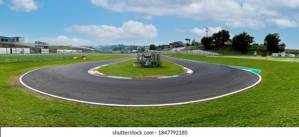 Hairpin bend turn in motorsport asphalt circuit scenic wide panoramic view