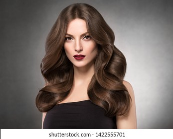 Hairstyle beautiful woman long curly brunette hair beautiful makeup young model