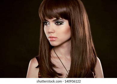 Hairstyle. Beautiful woman with long healthy brown hair.  Isolated on Black Background. Beauty Stylish Model Portrait