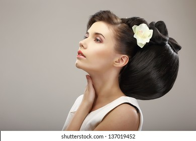 Hairstyle Contemporary Design. Sensual Woman with Creative Coiffure - Updo. Glamor