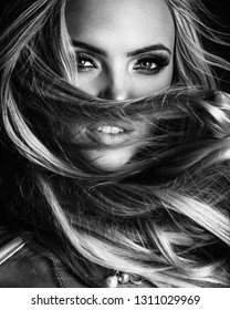 hairstyle, haircare and fashion concept - natural blond woman portrait with beautiful hair on grey background