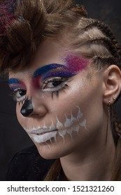 hairstyle for halloween. art make-up sugar skull, model shooting. A girl with black hellish eyes. Hairdressing. Hairstyle with colored sparkles. Beauty saloon. hairstyle contest