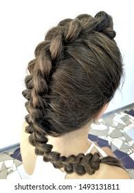 Hairstyle on long hair, braiding a fishtail
