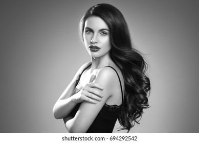 Hairstyle woman beautiful portrait.Beauty girl model with long perfect hair black and white