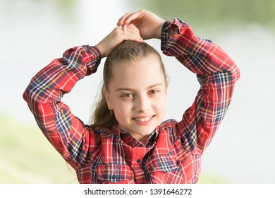 Hairstyles to wear on windy days. Feeling cozy and comfortable on windy day. Deal with long hair on windy day. Windproof hairstyles. Girl little cute child enjoy walk on windy day nature background.