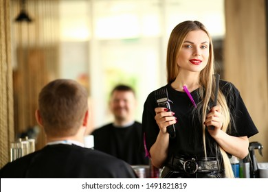 Hairstylist Hold Razor and Comb for Male Haircut. Female Hairdresser Showing Electric Shaver and Hairbrush for Styling Man Hairdo. Shave Client in Barbershop. Stylist with Tool Looking at Camera Shot