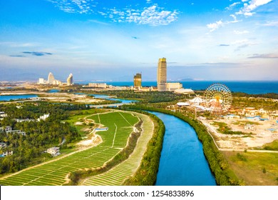 Haitang Bay, Sanya, Hainan Island, China - November 24, 2018: The Sanya Haichang Fantasy Town is under Construction near Luxury Resorts and Hotels Situated along the Coastline of Haitang Bay