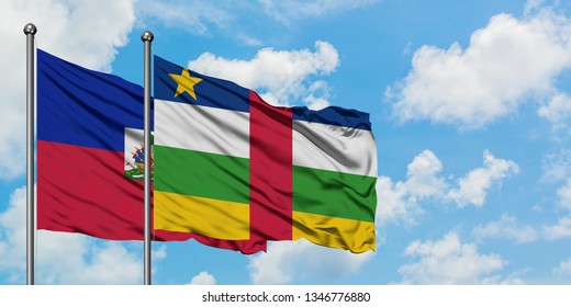 Haiti and Central African Republic flag waving in the wind against white cloudy blue sky together. Diplomacy concept, international relations.