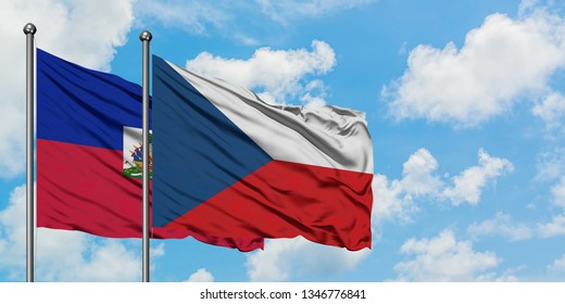 Haiti and Czech Republic flag waving in the wind against white cloudy blue sky together. Diplomacy concept, international relations.