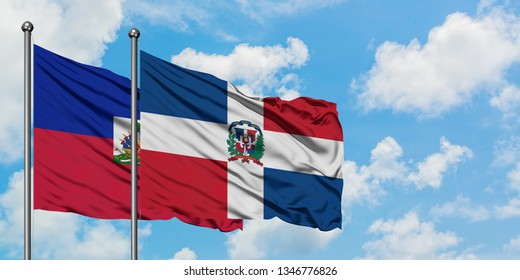 Haiti and Dominican Republic flag waving in the wind against white cloudy blue sky together. Diplomacy concept, international relations.