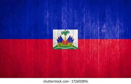 Haiti Flag on wood background
