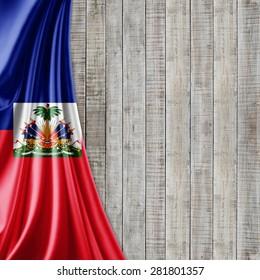 Haiti  flag of silk and wood background