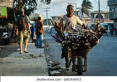 Cap-Haïtien, Haiti - January 12, 2009 : Men on the background of the city wall. Haiti is recognized as one of the poorest countries on Earth