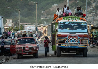 Cap-Haïtien, Haiti - January 12, 2009 : Passengers on the roof of the bus. Haiti is recognized as one of the poorest countries on Earth.