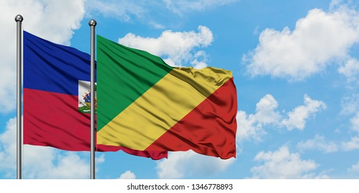 Haiti and Republic Of The Congo flag waving in the wind against white cloudy blue sky together. Diplomacy concept, international relations.