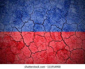 The Haitian flag painted on cracked ground with vignette