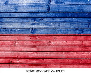 The Haitian flag painted on wooden fence