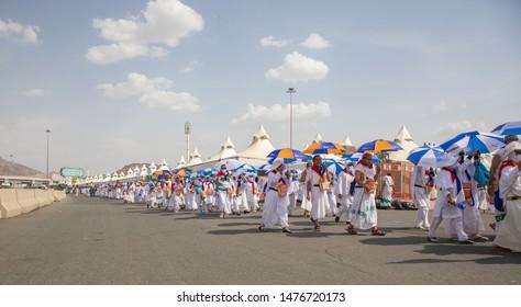 Hajj pilgrims walking, Day time, Performing Hajj, Mina, Makkah, Saudi Arabia, August 2019