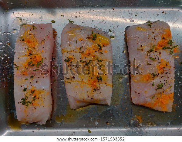 Hake spiced with aromatic herbs.