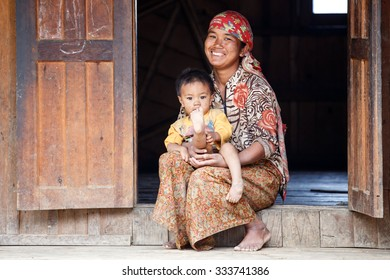 HAKHA, MYANMAR - JUNE 19 2015: Local woman and child in the Hakha region in Chin State, Myanmar.