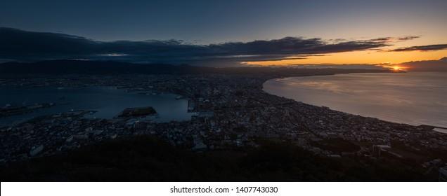 Hakodate city view from top of Hakodate mountain during sunrise, autumn season.