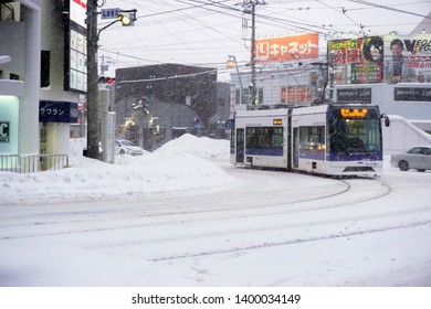 Hakodate, Japan, February 13, 2018 : Modern and electric trams run in urban and heavy snowfall. Trams are the main transportation for sightseeing in Hakodate, Run every 6 to 12 minutes during the day.