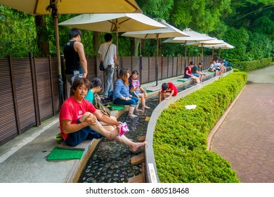 HAKONE, JAPAN - JULY 02, 2017: Unidentified people refresing their foots inside of water at Hakone Open-Air Museum or Hakone Chokoku No Mori Bijutsukan is popular museum featuring an outdoor sculpture
