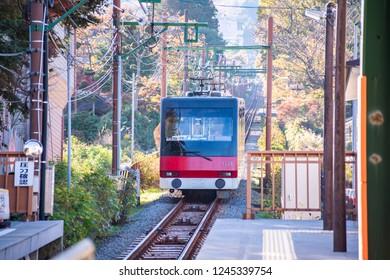 HAKONE, JAPAN - NOVEMBER 17, 2018: Hakone Tozan train is approaching the station .