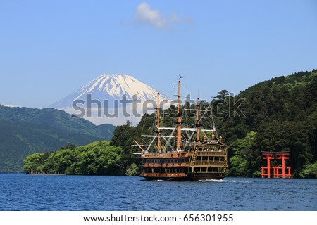 The Hakone Sightseeing Cruise (Hakone Pirate Ship) sails on the Ashinoko Lake with Mt. Fuji and a big red Torii (Gate to shrine) as background