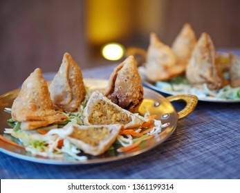 Halal chicken samosas and vegetable samosas, popular deep fried snack made with variety fillings. Ramadan food theme delicious dish cooked with blessing meat for Muslims. (close up, selective focus)