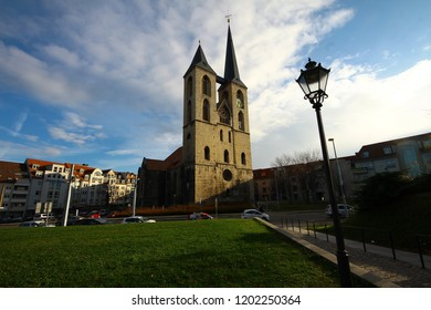 Halberstadt, Germany, Saxony Anhalt - November 29, 2017: Ancient Romanesque st. Martin church with two different spires in the centre of old town of Halberstadt. Cityscape, street view.