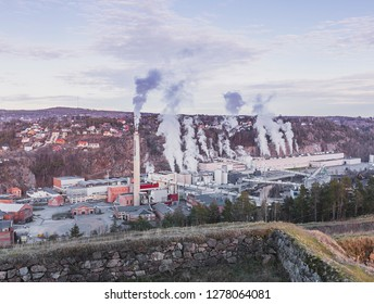 Halden aerial panoramic view on the winter day from Fortress Fredriksen to smoking pipes of cellulose factory, the sky is cloudy and blue, landscape. Halden, Norway - January 3, 2019.