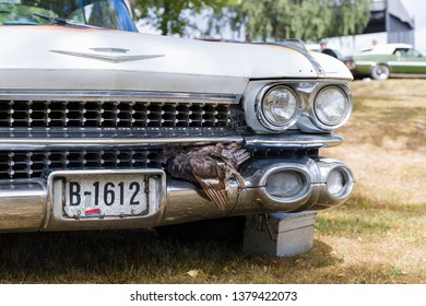 Halden, Norway - 12. August, 2018: 60's Cadillac styled with a dead capercaillie in the grill. Licence plate decorated with barbed wire.