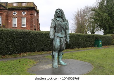 Hale, Cheshire, England, UK. 10 March 2018.  The Childe of Hale statue, standing in the village green.