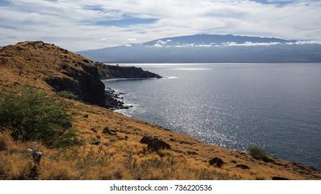Haleakala volcano seen in the distance from the coast of Maui, Hawaii