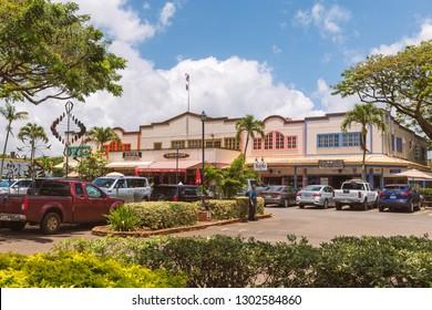 HALEIWA, HAWAII - JUNE, 2018: Souvenir shops wooden facades and car parking in Haleiwa, Oahu island