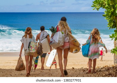 Haleiwa, Hawaii / USA - Jan. 1 2018: A young family heading to the beach in Hawaii
