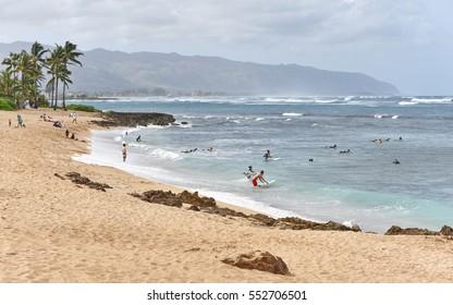 Haleiwa Hawaii, USA - November 25, 2016: People gather on Haleiwa Ali'i beach on Oahu island.