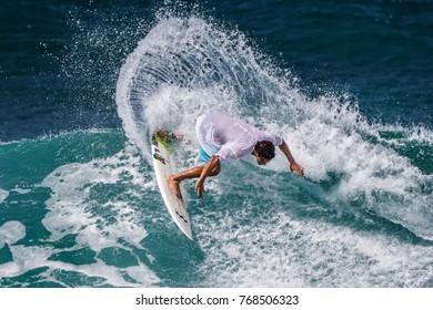 Haleiwa, Hawaii USA-Nov. 1 2012: A surfer rides a wave at Banzai Pipeline