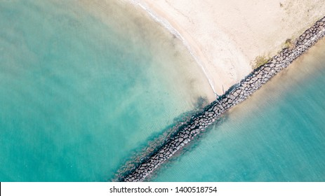 HALEIWA, USA: Drone view of Haleiwa Beach, in Hawaii. Geometric rock line and turquoise sea.