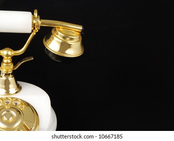 Half of an ancient luxurious telephone with marble and gold isolated