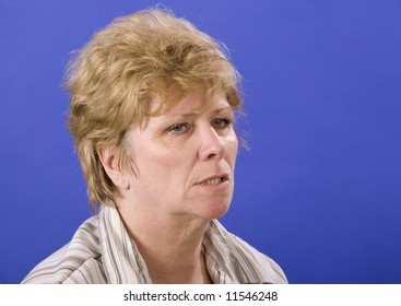 half angry woman isolated on blue