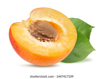 half of apricot with leaves isolated on a white background
