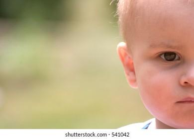 half of a baby boy's face
