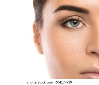 Half of beautiful female face on white background