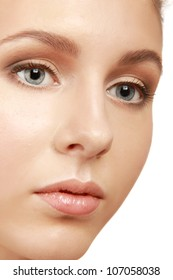 A half of a beautiful female's face, closeup, isolated on white