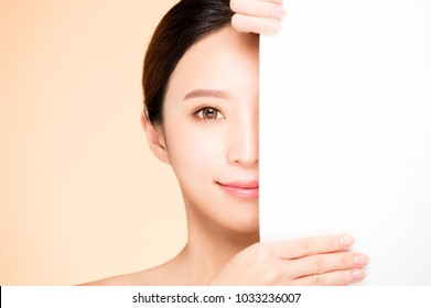 half  beauty face with blank board concept